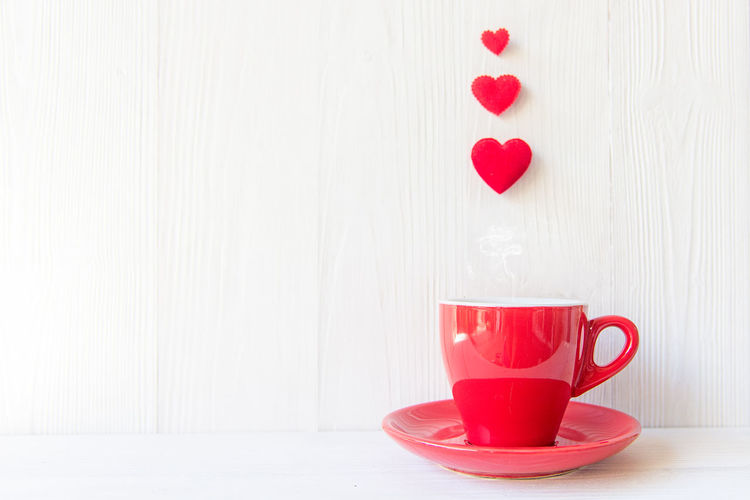 Close-up of heart shape coffee cup on table