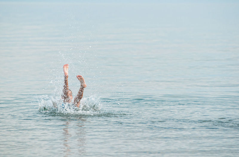 Full Length Of Man Enjoying In Sea