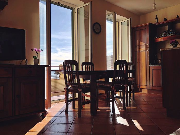 Empty chairs and table in living room at home
