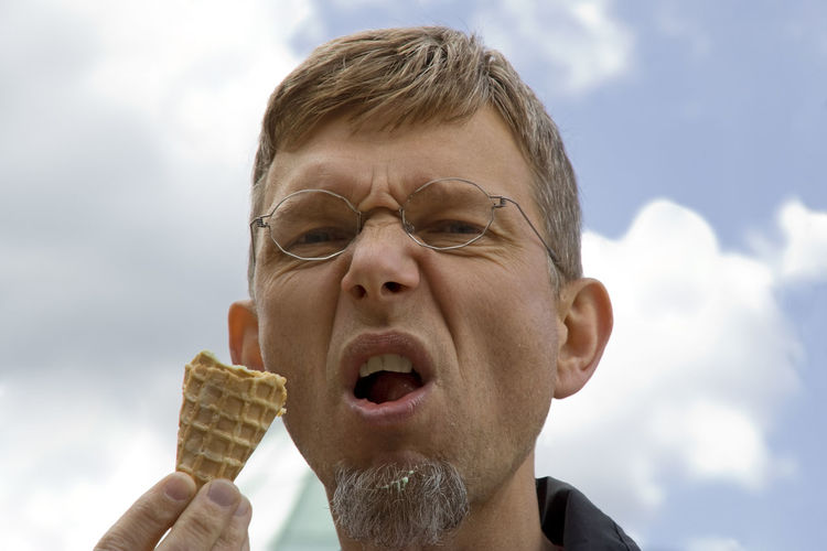 portrait of a mature man with ice cream cone - making a snout Attitude Beard Close-up Eyeglasses  Facial Experiments Food And Drink Frozen Food Fun Furious Headshot Holding Ice Cream Ice Cream Cone Looking At Camera Man Mature Men Mouth Open One Man Only One Mature Man Only Outdoors Portrait Real People Snout Sweet Food Unhealthy Eating