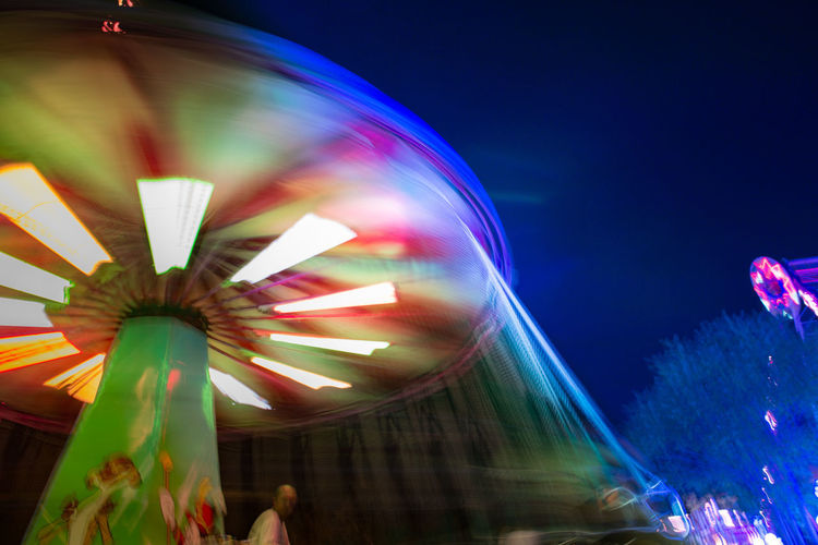 Long exposure of the amusement park of the capital city Ankara. Blurred Motion Motion Amusement Park Amusement Park Ride Night Long Exposure Arts Culture And Entertainment Speed Illuminated Multi Colored Spinning Ferris Wheel Carnival Low Angle View Enjoyment Fun Glowing Traveling Carnival Incidental People Leisure Activity Outdoors Nightlife Excitement Fairground Festival