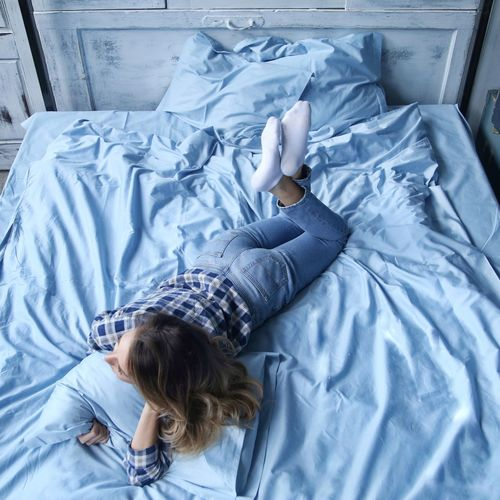 Bed Bedroom Indoors  High Angle View Sheet Home Interior One Person Lying Down Pillow Directly Above Pajamas People Domestic Life One Woman Only Adult Human Body Part Only Women Adults Only Day