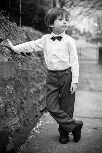 Autumn Bowtie Dressed Up Fashion Tuxedo Black And White Bokeh Boy Childhood Dapper Day Elementary Age Focus On Foreground Front View Full Length Handsome Lifestyles One Person Portrait Posing Real People Standing Walkway White Shirt Fashion Stories