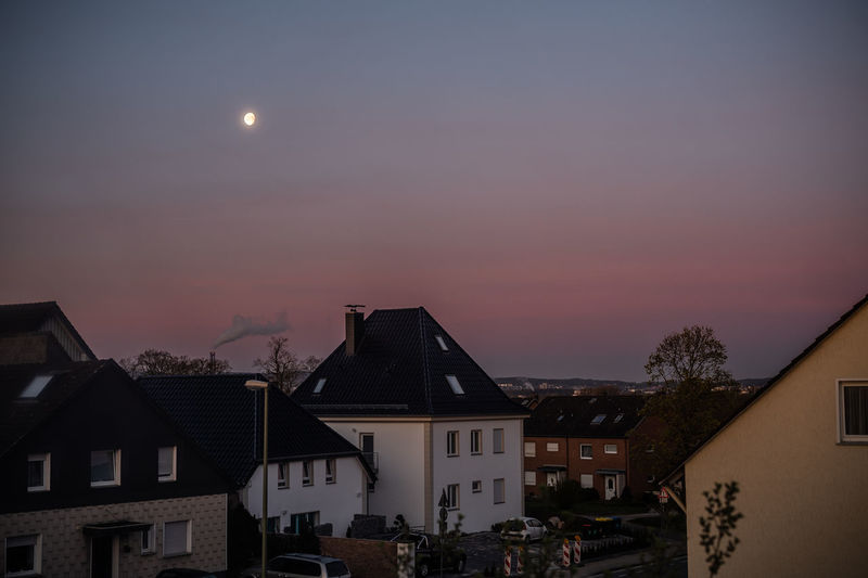 Buildings against sky at night