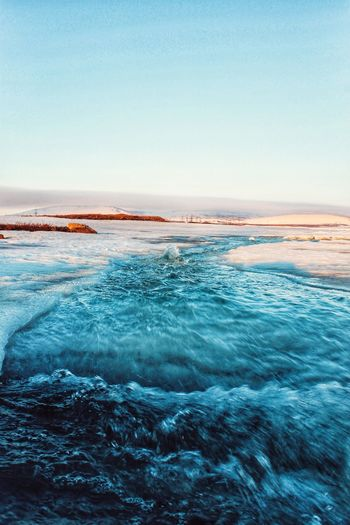 Scenic view of the tundra covered with snow and water in the spring sunset