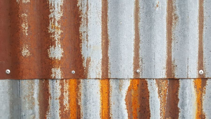 Metal Wall Industrial Industry Industrial Photography Architecture Architectural Detail Backgrounds Corrugated Iron Textured  Full Frame Pattern Striped Close-up Rusty Weathered Run-down Damaged Ruined Abandoned Nut - Fastener Deterioration Bad Condition Sheet Metal