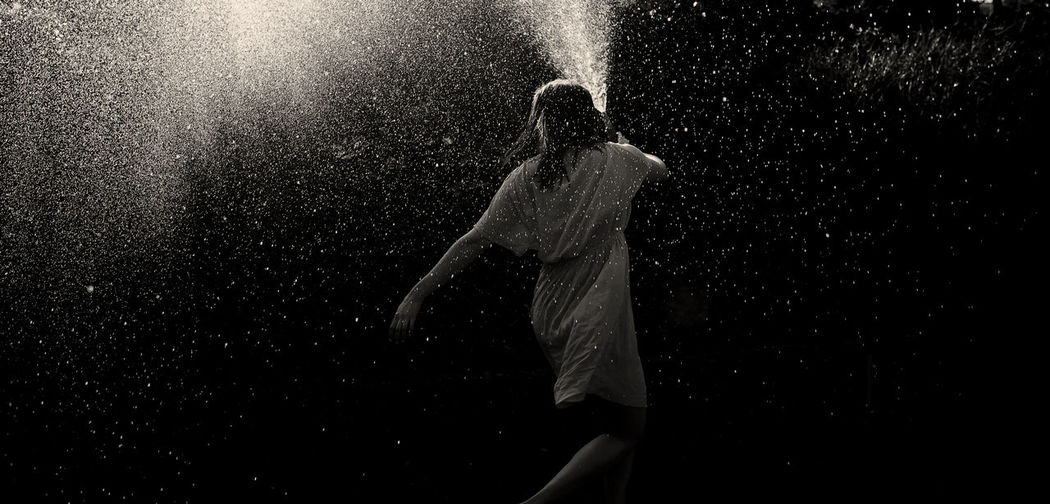 Alone Black And White Dance Enjoying Life Fountain Girl Lifestyles Motion Night Rain Shower Splashing Water Wet The Portraitist - 2016 EyeEm Awards Young Women The Essence Of Summer- 2016 EyeEm Awards Fine Art Photography Light Light And Reflection