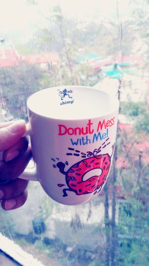 Donu mess with me Human Hand Human Body Part Drink Holding One Person Refreshment Close-up Outdoors Food And Drink Cup People Text Building Exterior City Day Red Winter Tree Freshness Nature