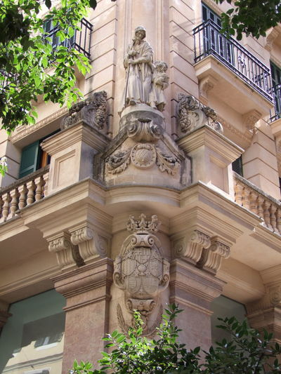 Corner Building Feature, Palma Architecture City Palma Palma De Mallorca SPAIN Sunlight And Shade Architectural Feature Architecture Balconies In The Building Building Exterior Building Feature Built Structure Capital City Corner Full Frame Leaves Low Angle View No People Outdoor Photography Sculpture Stone Carved Traditional Building