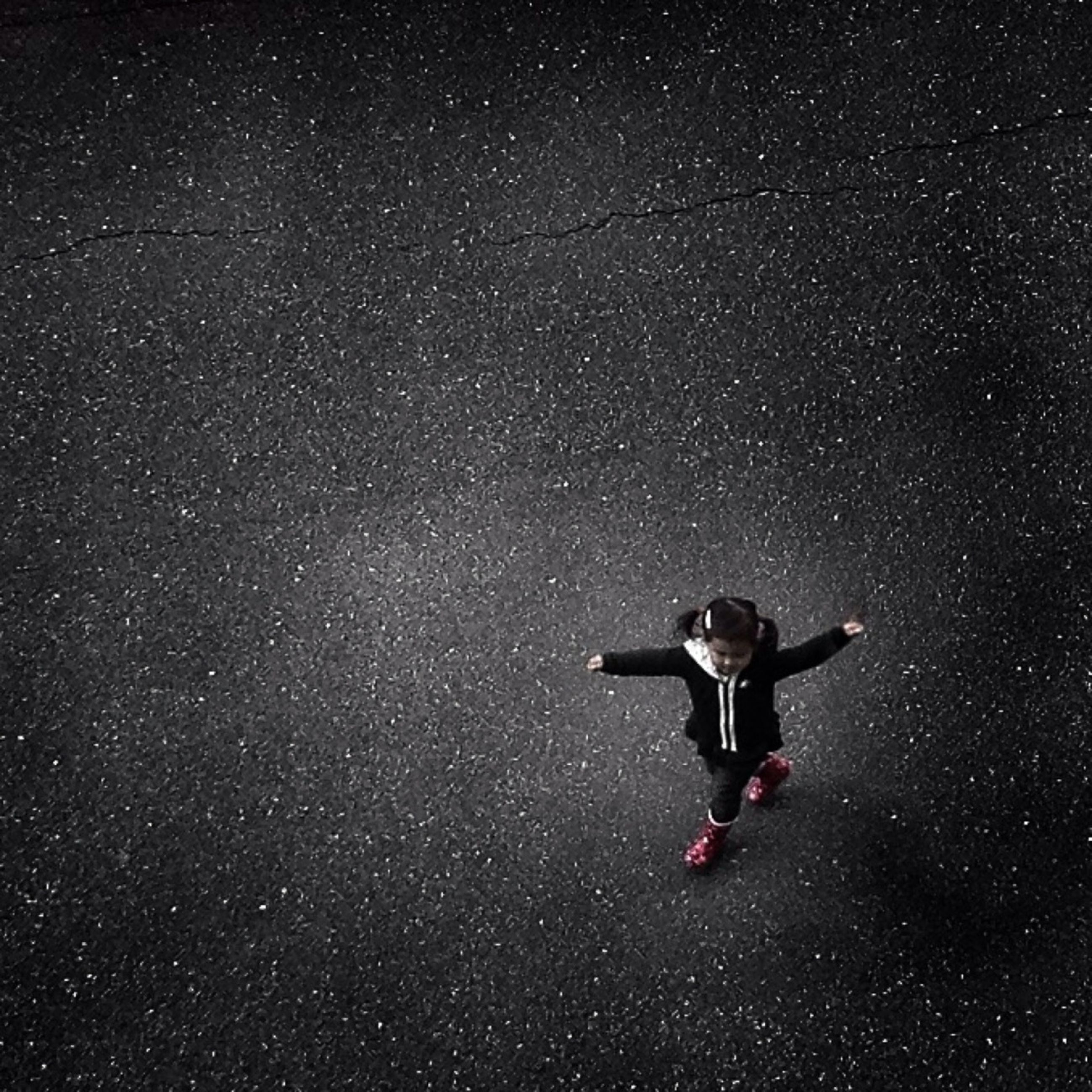 night, one person, sky, star field, mid-air, star - space, full length, weather, astronomy, low angle view, flying, tranquility, nature, transportation, outdoors, exploration, galaxy, beauty in nature, high angle view, motion