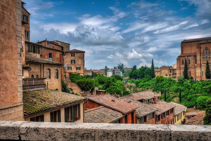 The beautiful colour of Siena Tuscany Italy Italia Italy Toscana Architecture Building Exterior Built Structure Building Sky Cloud - Sky The Traveler - 2018 EyeEm Awards History Travel Destinations City Town Residential District The Past Wall