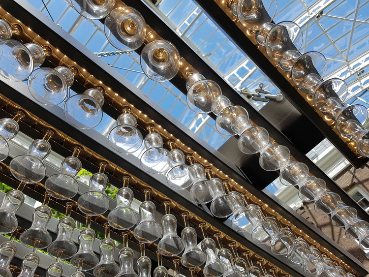 Glasses Lamp Indoors  Low Angle View No People Architecture Day Sky Blue Sky Indoor Architecture Design
