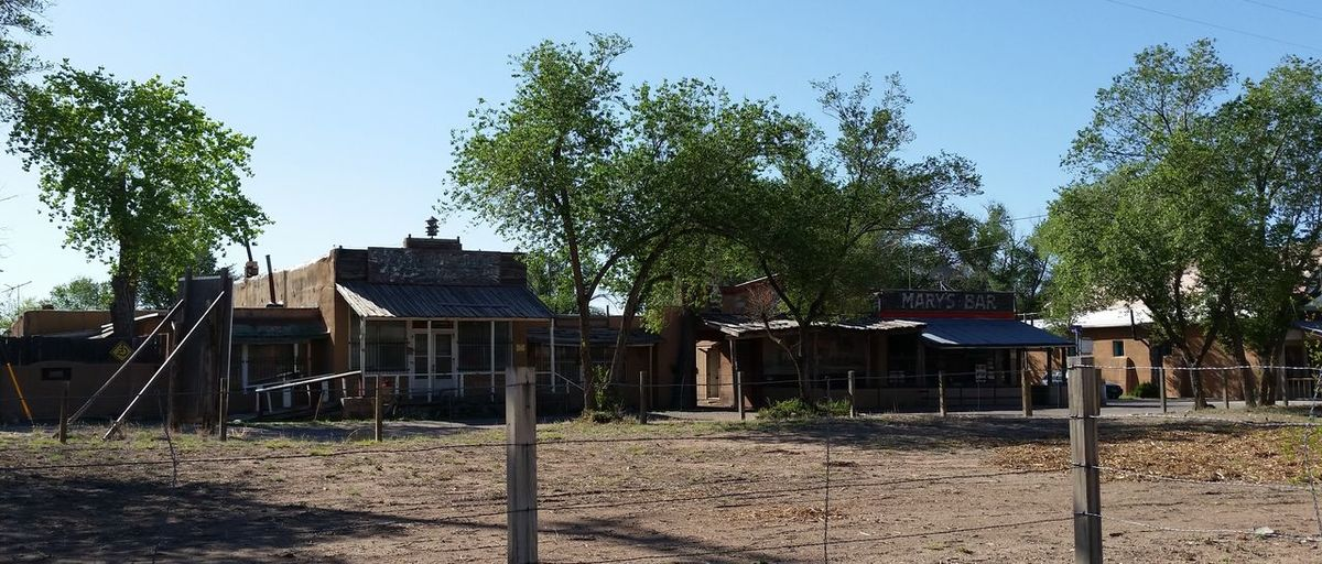 Mary's Bar and an abandoned building in Cerrillos, New Mexico. Abandoned Bar Barbed Wire Fence Cerrillos Day Derelict Ghost Town Mary's Bar New Mexico No People Old Buildings Rundown Small Town Tavern  What Not Shop