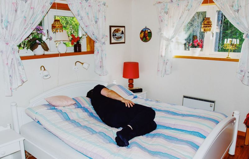 Man lying down on bed at home