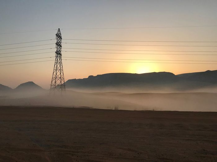 Desert highway in early winter morning. Construction Tranquility Calm Sun Sky Dune Desert Power Line  Electric Pole Sunrise Morning Myst Fog Sky Sunset Animals In The Wild Animal Vertebrate Animal Themes Large Group Of Animals Silhouette Tranquil Scene Tranquility Landscape Non-urban Scene No People Beauty In Nature