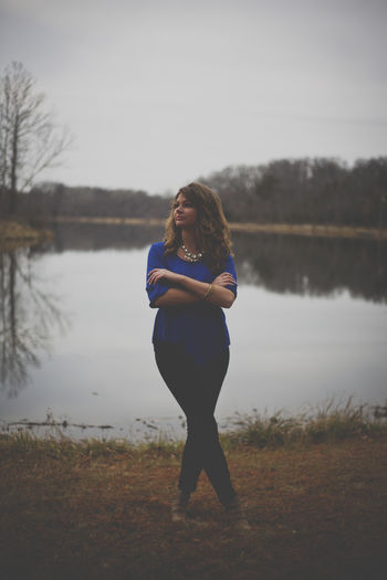 Beauty In Nature Carefree Casual Clothing Day Focus On Foreground Full Length Innocence Lake Lakeshore Leisure Activity Lifestyles Long Hair Nature Non-urban Scene Person Scenics Sky Standing Tranquil Scene Tranquility Vacations Water Woman