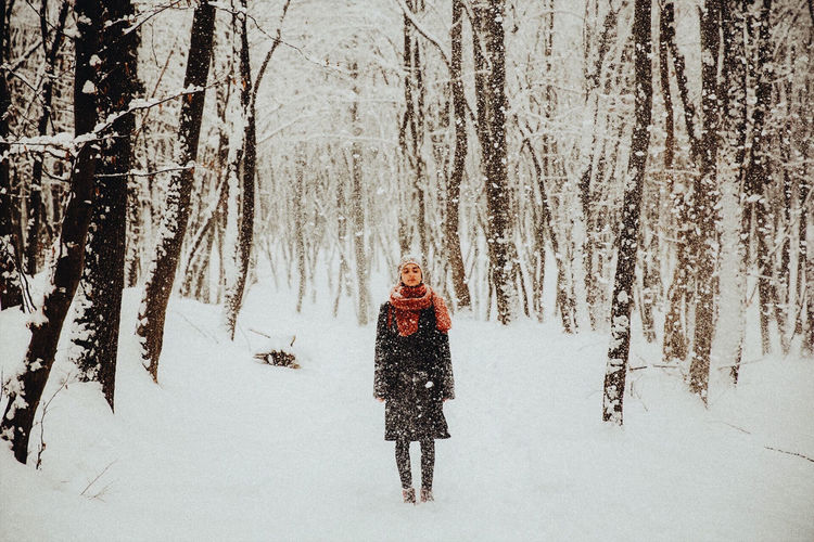Person on snow covered field during winter