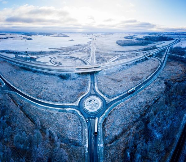 Winter highway junction Street Highway Freeway Aerial Lithuania Lietuva Interstate Roundabout Ring Road Circle Traffic Traffic Circle Panoramic Winter Cold Blue Road Full Frame Snow Covered Snowfall Two Lane Highway Overpass Viaduct Road Intersection High Street