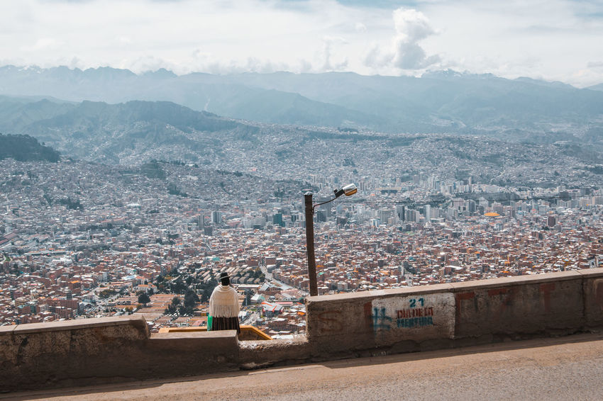 El Alto Views. City Life Cityscape El Alto La Paz Latin America Travel Architecture Building Building Exterior Built Structure Cholita City Cloud - Sky Environment High Angle View Mountain One Person Outdoors Residential District South America Street TOWNSCAPE Travel Destinations Urban Urbex The Photojournalist - 2018 EyeEm Awards The Traveler - 2018 EyeEm Awards The Portraitist - 2018 EyeEm Awards The Street Photographer - 2018 EyeEm Awards