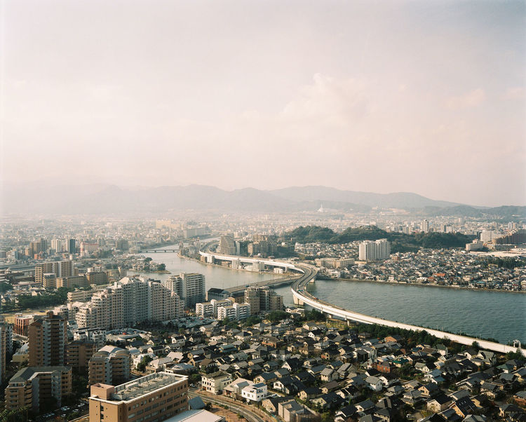 Fukuoka, Kyūshū, Japan from above. Film Fukouka Japanese  KYUSHU Morning Travel Vista Adventure Aerial View Architecture Building Exterior Built Structure City Cityscape Day High Angle View Highway Motorway No People Outdoors River Sky Skyscraper Travel Destinations Vacation