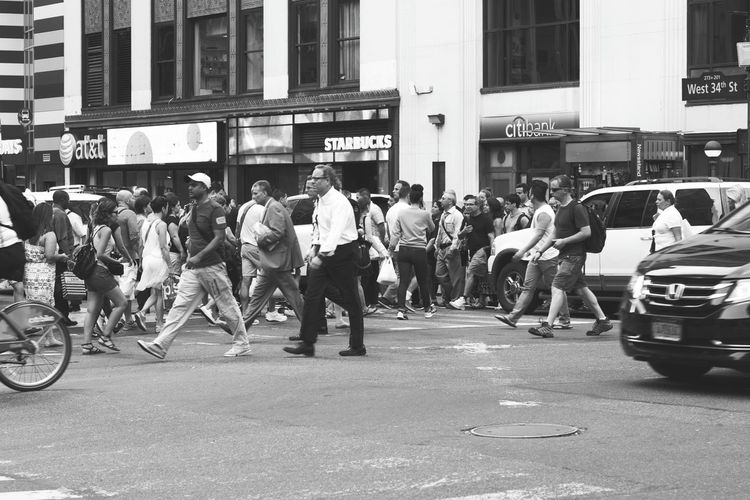 Midtown Mass. Black And White Photography Streetphoto_bw NYC Street Photography Pedestrians Crossing The Street Cars Rush Hour Starbucks Sony A6000 Project365