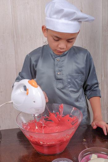 Boy preparing food in kitchen