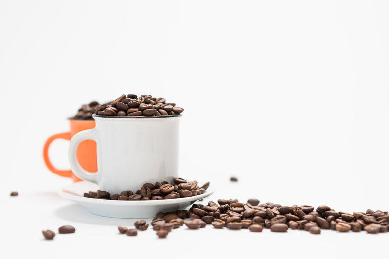Coffee Cups Filled with Coffee Beans on a White Background Concept with Copy Space Food And Drink Coffee - Drink Food White Background Roasted Coffee Bean Coffee Still Life Cup Freshness Indoors  Mug Studio Shot No People Coffee Cup Drink Copy Space Large Group Of Objects Brown Refreshment Roasted Crockery Caffeine