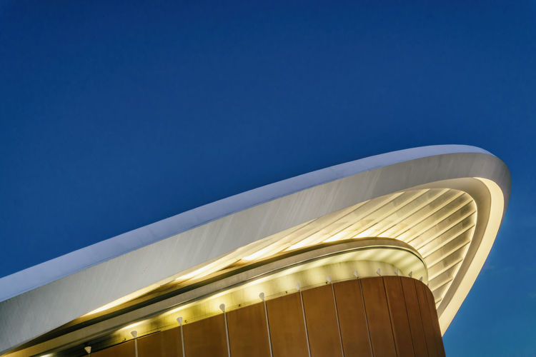 Close-Up of Part of Roof of Haus Der Kulturen Der Welt at Dusk Berlin Germany 🇩🇪 Deutschland Color Image Horizontal Outdoors No People Haus Der Kulturen Der Welt Roof Sky Copy Space Built Structure Architecture Low Angle View Clear Sky Building Exterior Modern Dusk Illuminated Part Of City Life Arts Culture And Entertainment Twilight German Culture Clear Sky