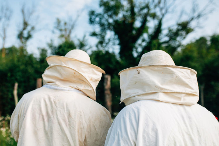 Rear view of beekeepers