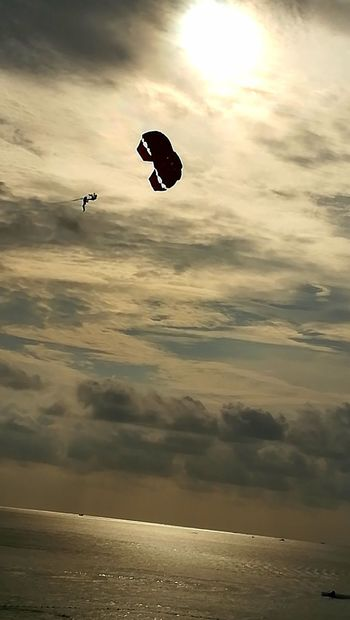 Parachuting in clouds Tranquil Scene Golden Light Golden Hour Cloudscape Clouds Sunsets Silouette & Sky From My Point Of View Cloudy Sunset_collection Sunset Silhouettes Sunlight Parachuting Sunset Flying Mid-air Sea Sky Nature Beauty In Nature Scenics Cloud - Sky Outdoors Water Silhouette Parachute Horizon Over Water Paragliding Day Beach