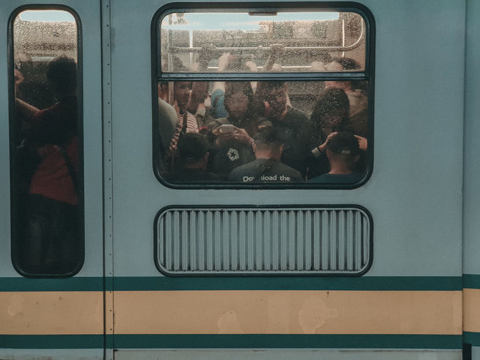 People seen through train window