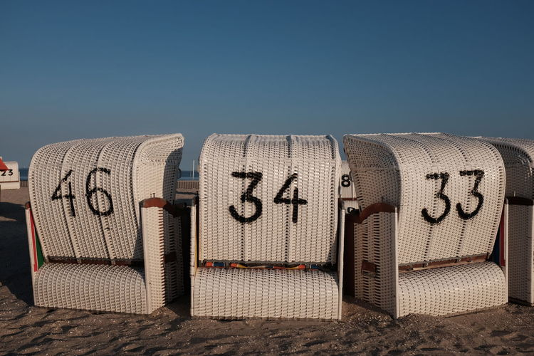 33 34 46 Beach Beach Life Beach Photography Beachphotography Birthday Blue Clear Sky Commercial Sign Communication Hooded Beach Chair Man Made Object No People Nordsee Number Numbers Outdoors Seat Strandkorb Studio Shot Text Three Western Script