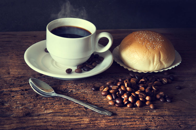 Hot Coffee cup and coffee beans, bred on a wood table,Vintage color tone Food And Drink Coffee Coffee - Drink Cup Freshness Drink Refreshment Spoon Table Mug Coffee Cup Roasted Coffee Bean Still Life Caffeine Hot Coffee Breakfast Bread Morning Vintage