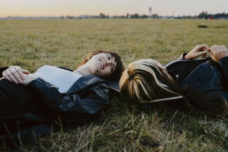 Woman resting on field