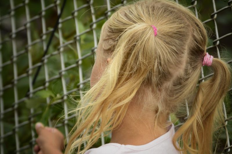 Blond Hair Child Childhood Girls Headshot Rear View Long Hair Close-up Chainlink Fence Braided Fence Human Back Boundary Chainlink Back Tangled Hair This Is Natural Beauty A New Perspective On Life My Best Photo
