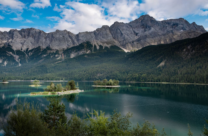 Der Eibsee Eibsee Beauty In Nature Cloud - Sky Day Environment Garmisch-partenkirchen Lake Landscape Mountain Mountain Peak Mountain Range Nature No People Non-urban Scene Outdoors Plant Range Reflection Scenics - Nature Sky Tranquil Scene Tranquility Tree Water