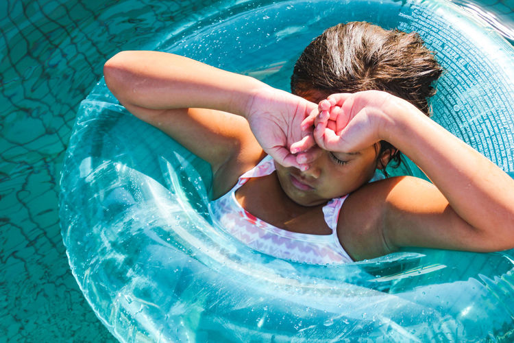 High angle view of baby girl in swimming pool