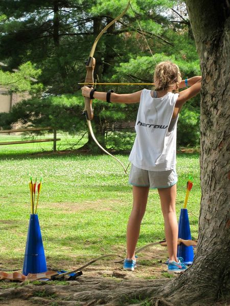 Girl practicing archery, 2013. Agility Aiming Athlete Grace Practice Aim Archery Athletes Athleticism Katniss Lifestyles Outdoors Practicing Recurve Bow Shooting Sport Sports Strength Strong Summer Target Practice Target Shooting Teen Teenager Camp