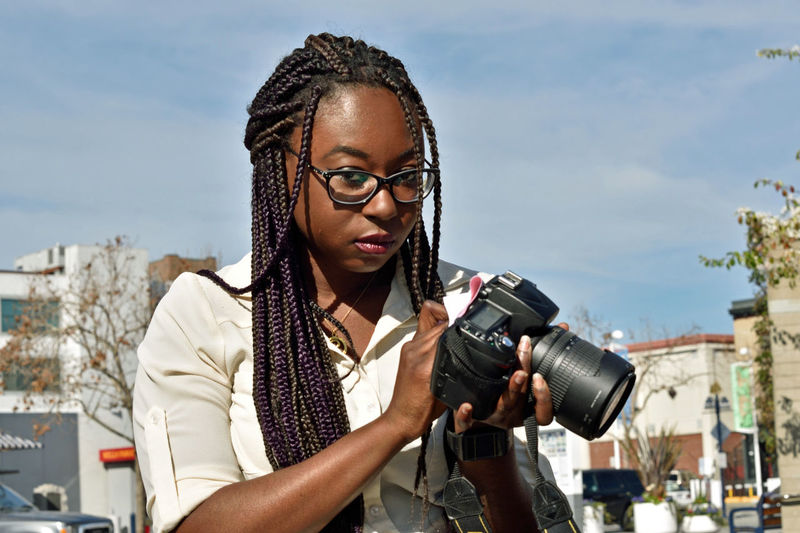 WomeninBusiness woman photograper 1 On Assignment In The Field Middle Harbor Port Of Oakland, Ca. Graphic Designer Showcase: February