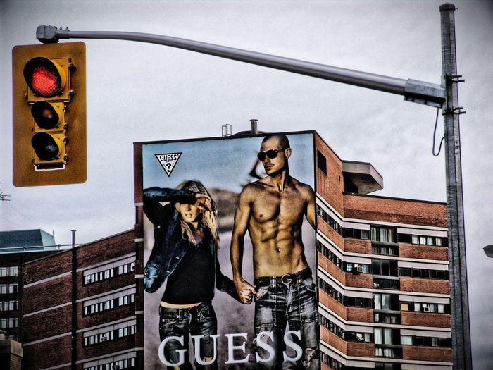 Streetlight with Billboard Zeitgeist Stopsign Redlight Streetphotography New York USA Fashion Billboard Couple Adam And Eve