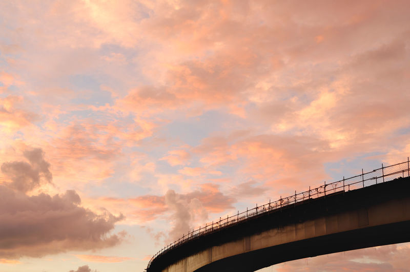 Low angle view of bridge against sky during sunset