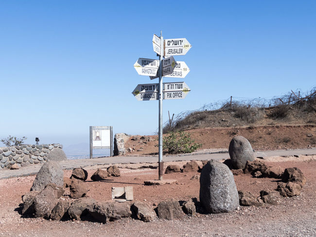 Directions sign on Mount Bental on the border between Israel and Syria Arrow Choice Choosing Middle East Nature Road Sign Sunlight Syria  Traffic Blue Border Communication Day Direction Directional Guidance Guide Israel Landscape Mount Bental Object Pointer Signpost Way