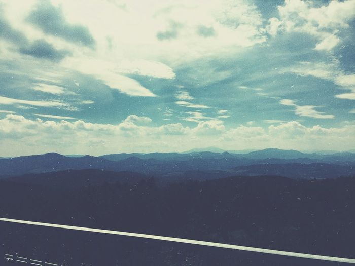 Mountain Tranquil Scene Tranquility Landscape Mountain Range Scenics Cloud Road Sky Beauty In Nature Non-urban Scene Solitude Cloud - Sky Nature Majestic Outdoors Remote Eyem Gallery Dark Calm