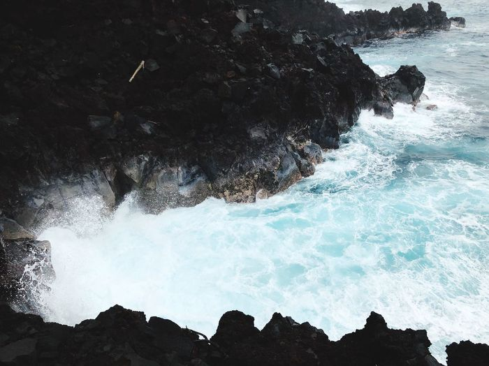 Heavy waves crashing Traveling Wild Hawaii Stone Black Waves Sea Wave Rock - Object Rock Formation Nature Beauty In Nature Water Power In Nature Motion No People Scenics Day Outdoors