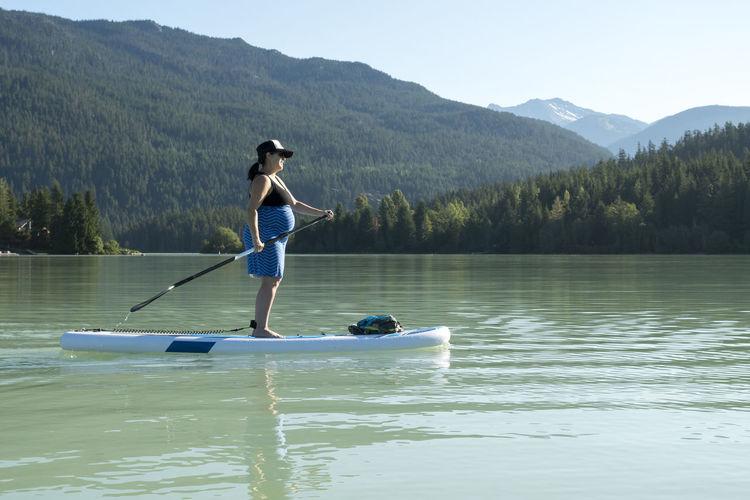 Full length of senior man on boat in lake