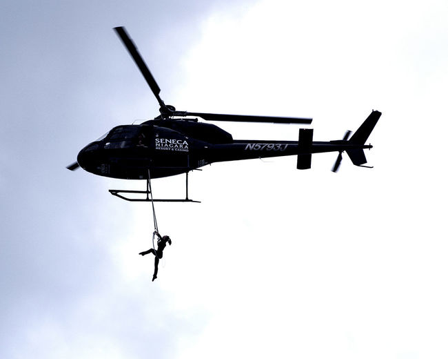 Acrobat Acrobatics  Aerial Air Vehicle Daredevil Day Erenida Wallenda Flying Helicopter June 14 2017 Low Angle View Mid-air New York Niagara Falls NY Outdoors Sky Stunt United States USA Photos