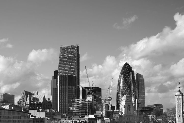 Low angle view of 30 st mary axe and towers in city