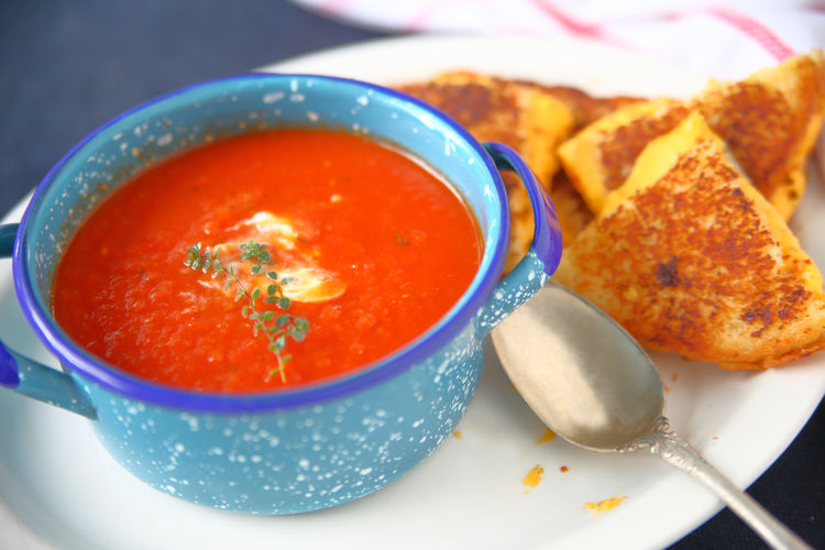 Tomato soup and grilled cheese Bread Close-up Colorful Day Dinner Dish Towel Fresh Herbs  Grilled Cheese Healthy Eating Indoors  Light Supper Lunch Natural Light No People Overhead Ready-to-eat Red Snack Spoon Studio Shot Textures Thyme Tomato Soup White Platter Yellow