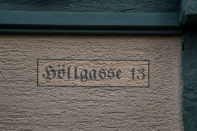 Number 13 of the house with green letters Text Western Script Communication Wall - Building Feature No People Architecture Sign Building Exterior Built Structure Day Close-up Wall Script Outdoors Non-western Script Craft Information Textured  City History Message