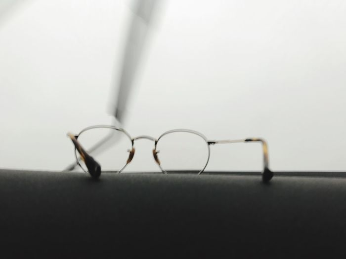 Indoors  No People Close-up Still Life Wall - Building Feature Selective Focus Shadow Glasses Technology Studio Shot Absence Wire Wall Eyeglasses  White Background Table Single Object Copy Space Metal